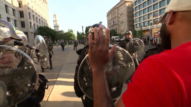 black lives matter protesters cleared from outside st john's church for trump photo opportunity; usa: washington dc: ext further shots of riot police... - protestor stock videos & royalty-free footage