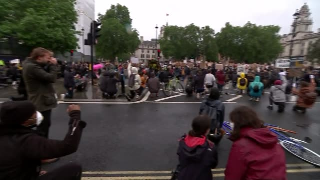 black lives matter protests take place across uk england london westminster parliament square various of demonstrators kneeling for minute's silence - kniend stock-videos und b-roll-filmmaterial