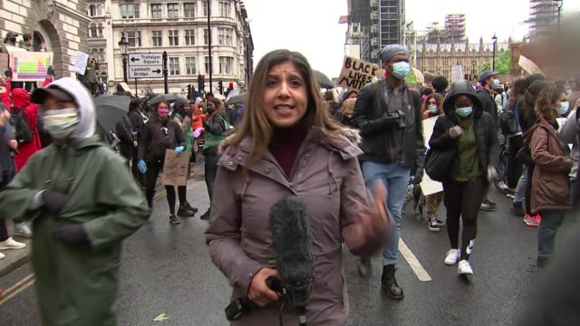 black lives matter protests take place across uk; england: london: westminster: parliament square: reporter to camera - journalist stock videos & royalty-free footage
