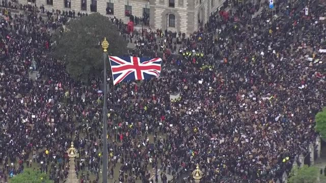 black lives matter protests take place across uk; england: london: westminster: ext air view / aerial large crowd of black lives matter protesters... - aerial view stock videos & royalty-free footage