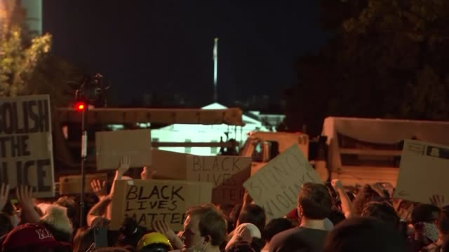 hundreds attend tribute to george floyd at minneapolis memorial; usa: washington dc: ext national guard troops night crowd of protesters holding... - washington dc bildbanksvideor och videomaterial från bakom kulisserna