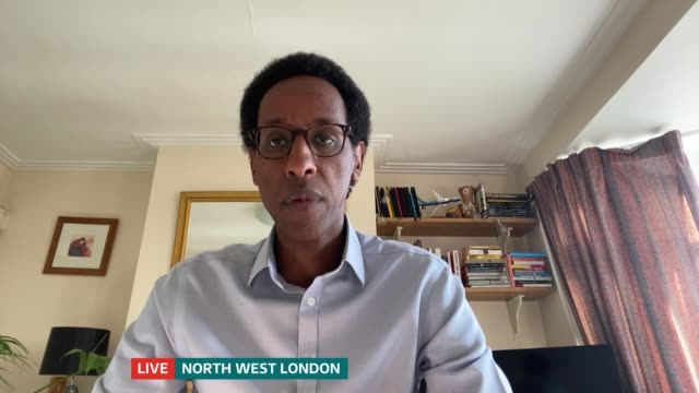 protest march through streets of brixton in solidarity england london gir int hashi mohamed live interview via internet sot - politics stock videos & royalty-free footage