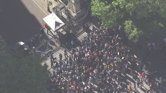 stockvideo's en b-roll-footage met protesters march in london berlin and copenhagen to show solidarity england london westminster protesters gathered at downing street gates - politics