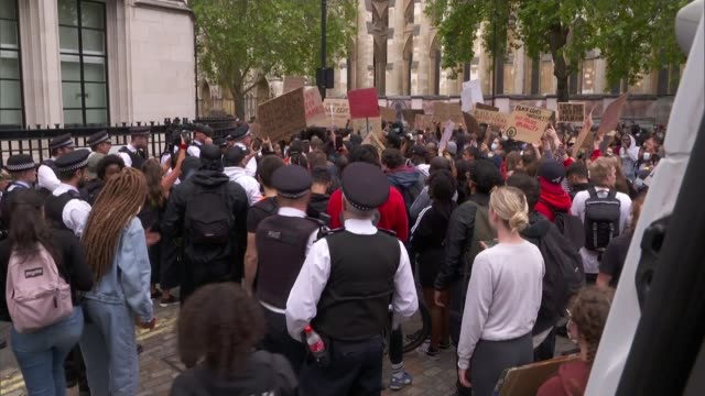 thousands join black lives matter protests across london and the uk; england: london: westminster: ext various shots of black lives matter protesters... - moving activity stock videos & royalty-free footage