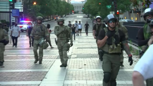three more police officers to be charged as protests continue in the us usa washington dc ext military police along pan group of riot police gun held... - weaponry stock videos & royalty-free footage