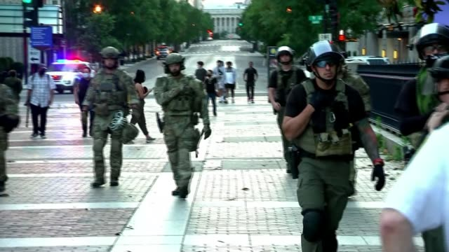 three more police officers to be charged as protests continue; usa: washington dc: ext military police along group of riot police gun held by officer... - weaponry stock videos & royalty-free footage