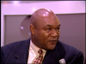 stockvideo's en b-roll-footage met george foreman at the natpe 96 at las vegas sands convention center in las vegas, nevada on january 22, 1996. - natpe convention