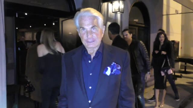 george hamilton joins joan collins for dinner at craig's restaurant in west hollywood in celebrity sightings in los angeles - west hollywood stock videos & royalty-free footage