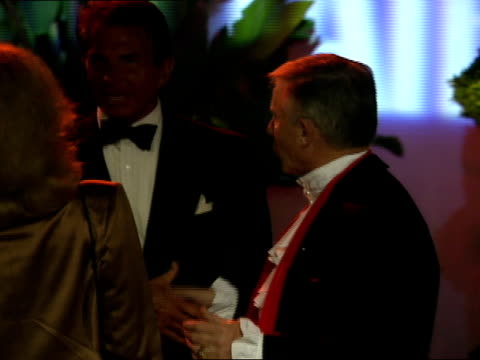 george hamilton on the red carpet at the vanity fair oscar party. - oscar party stock videos & royalty-free footage