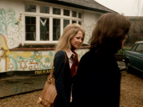 George Harrison and his wife Patti Boyd pose for photographers outside their home