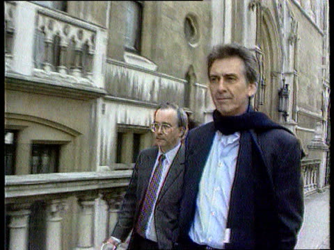 george harrison attacker appears in court; c5l: u'lay lib england: london: high court: slow motion george harrison towards with others arriving at... - george harrison stock videos & royalty-free footage