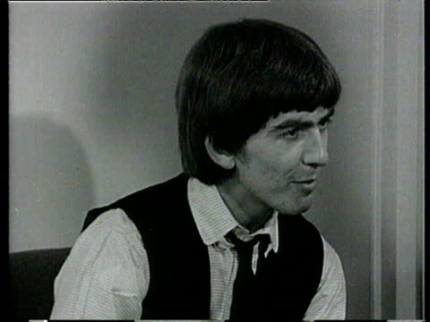 george harrison of the beatles is surrounded by birthday cards from fans / harrison interviewed about how much he's received and says thank you to... - george harrison stock videos & royalty-free footage