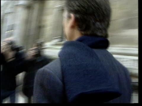 george harrison receiving cancer treatment; lib england: london: high court: musician, george harrison, along to high court lib oxfordshire: air view... - itv late evening bulletin点の映像素材/bロール