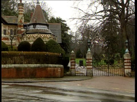 harry smith england oxfordshire henley ext police officers outside gates of home of george harrison sign on gates 'friar park' entrance to estate... - shaving equipment stock videos & royalty-free footage