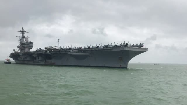 george hw bush anchored in stokes bay near portsmouth harbour today ahead of a training excercise with british troops. the vessel has been a major... - anchored stock videos & royalty-free footage