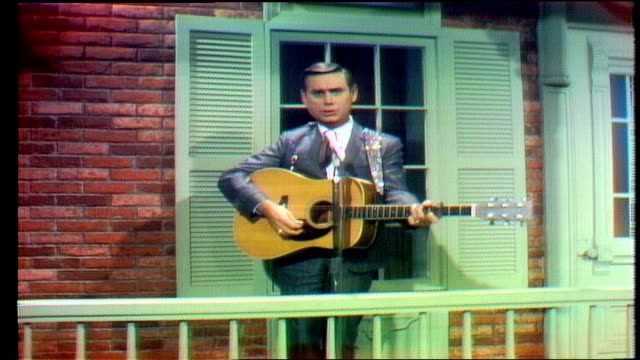 """george jones performs """"i'll be over you george jones plays acoustic guitar and sings pedal steel guitar being played - country and western stock videos and b-roll footage"""