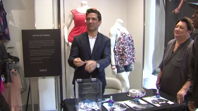 George Kotsiopoulos and contest winner Kesha Adams at Fastest Growing Plus Size Fashion Brand TORRID Opens Flagship Store On Chicago's State Street...