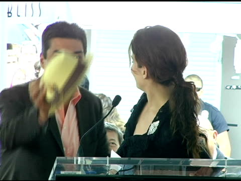 George Lopez gives Sandra Bullock his hat at the Dedication of Sandra Bullock's Star on Hollywood Walk of Fame at Hollywood and Highland in Hollywood...