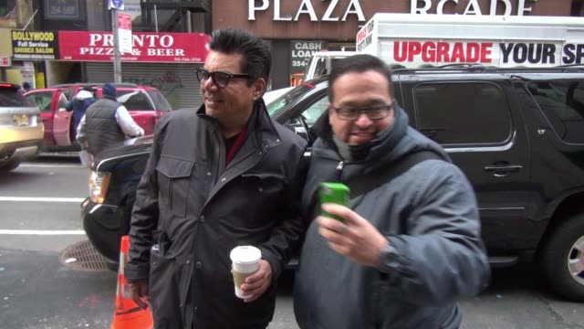 George Lopez poses for photos with fans after arriving at the TODAY show in Celebrity Sightings in New York