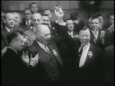 george meany walter reuther clasp raised hands in unity / aflcio merger - menschliche gliedmaßen stock-videos und b-roll-filmmaterial