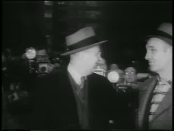 george metesky in eyeglasses + hat smiling / press in background - 1957 stock videos & royalty-free footage