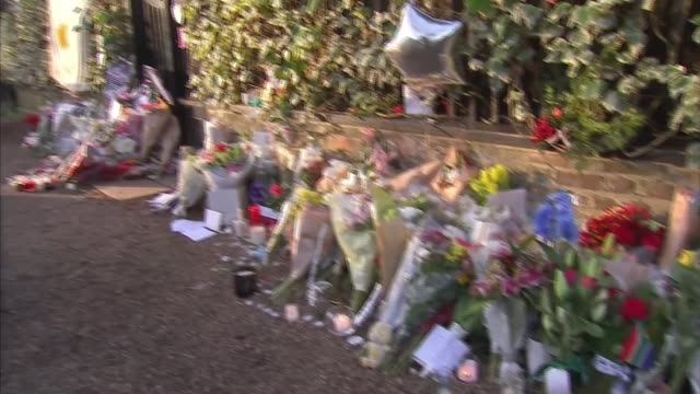 Fans tributes as revealed he was a secret donor to many charities ENGLAND London Highgate EXT Floral tributes outside George Michael's house PAN...
