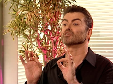 george michael interview george michael interview sot all i'm saying is i went out last tuesday night and did something my boyfriend accepts i enjoy... - ホモフォビア点の映像素材/bロール