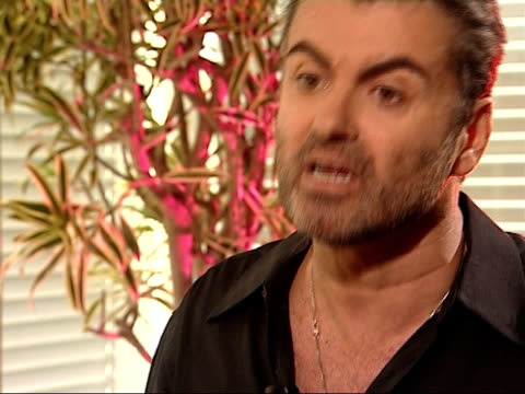 george michael interview george michael interview sot argues with reporter about her continued questioning about his lifestyle decisions / i'm not... - homophobia stock videos and b-roll footage