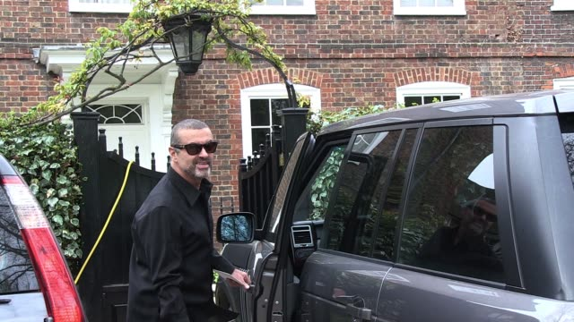 George Michael Leaves His North London Home Clutching The Master Copy Of New Single Which