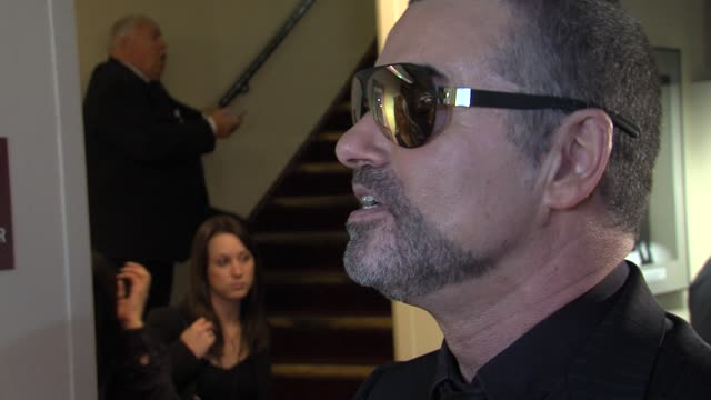 george michael on x factor, if he would be a judge, artists he would like collaborate with at the george michael performs at royal albert hall in... - judge entertainment stock videos & royalty-free footage