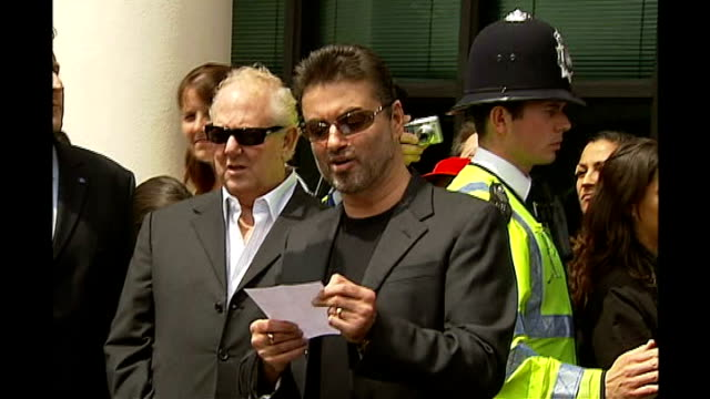 George Michael receives community sentence and driving ban for unfit driving ENGLAND London Brent Magistrate's Court EXT George Michael reading...