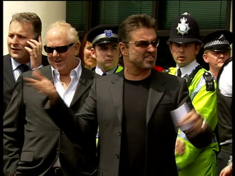 George Michael receives community sentence and driving ban for unfit driving George Michael exiting court and gesturing to crowds to be quiet George...