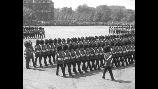 george on horseback watches royal guards marching in formation on horse guards parade / george in full dress uniform on horseback rides across parade... - prince stock videos and b-roll footage