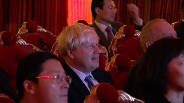 george osborne and boris johnson in beijing on trade missions; china: beijing: ext / night reporter to camera int cutaways boris johnson sitting in... - westernisation stock videos & royalty-free footage