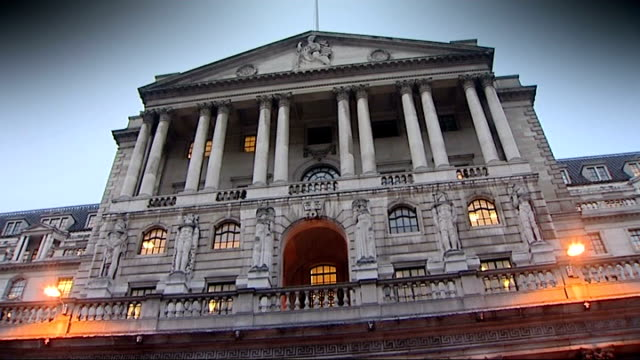 george osborne announces banking stimulus plan; ext bank of england at dusk 'threadneedle street' road sign int close shot of man counting banknotes... - counting stock videos & royalty-free footage