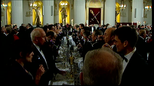 vídeos y material grabado en eventos de stock de george osborne announces banking stimulus plan; london: mansion house: people standing at the lord mayor of the city of london's annual dinner to the... - gala