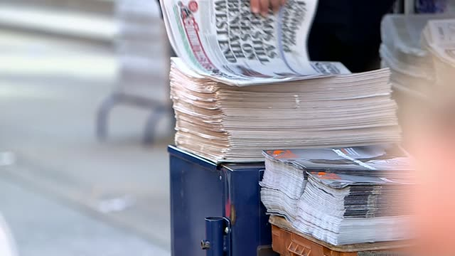 george osborne appointed editor of the london evening standard newspaper r14041523 / newspaper vendor handing out copies of evening standard newspaper - vender stock videos and b-roll footage
