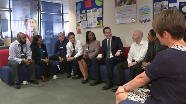 george osborne asks government departments to find 20 billion pounds of savings; hammersmith: george osborne seated chatting with staff suring visit... - フリーズフレーム点の映像素材/bロール
