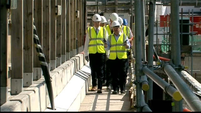 george osborne at construction site and intvw england north london crick institute ext gvs of construction site / gvs george osborne mp along at... - laura kuenssberg stock-videos und b-roll-filmmaterial