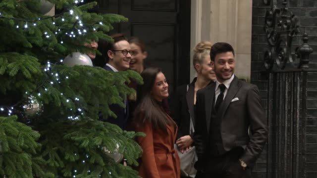 george osborne christmas party arrivals; theresa may mp into 10 downing street / janette manrana arrives and poses for photos by christmas tree /... - christian horner stock videos & royalty-free footage