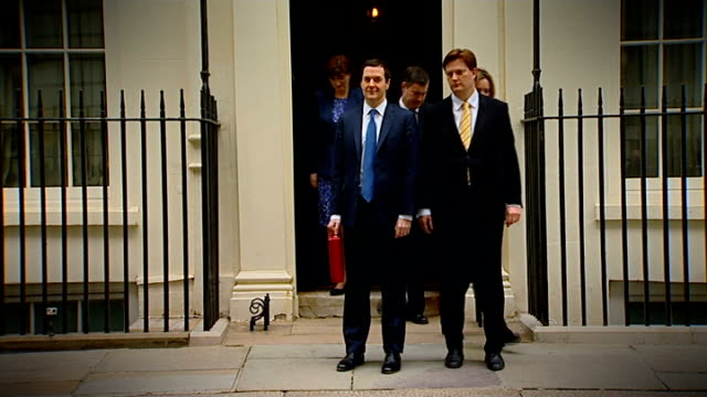 George Osborne delivers 2014 Budget Downing Street George Osborne MP departing Number 11 with Treasury ministers including Danny Alexander MP Osborne...