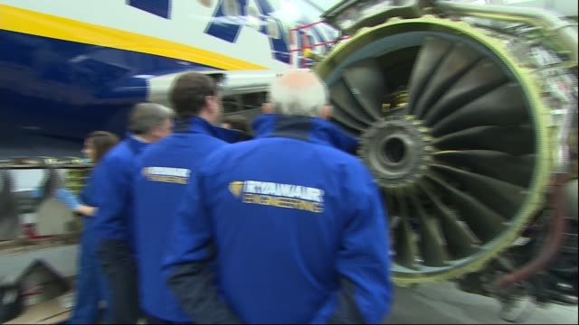 george osborne ed balls and vince cable visit to england essex stansted int george osborne mp ed balls and sir vince cable being shown plane turbine... - equipaggio video stock e b–roll