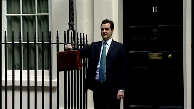 George Osborne hints at bigger cuts to benefits TX EXT George Osborne MP posing with red budget box outside Number 11