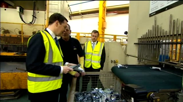 George Osborne plans to cut public spending by another 25 billion pounds INT George Osborne MP touring Sertec automotive factory Osborne chatting to...