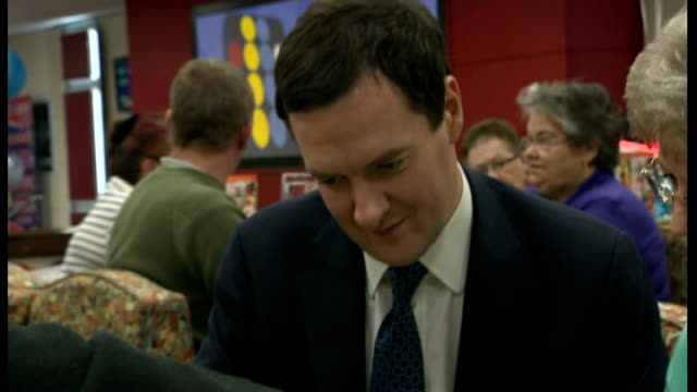 vídeos y material grabado en eventos de stock de george osborne plays bingo in cardiff wales cardiff photography** various shots of george osborne mp playing bingo / osborne chatting to people in... - bingo