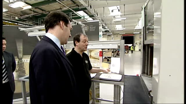 george osborne talks of cancelling fuel duty increase wales llantrisant royal mint int newly minted pound coins handled by george osborne mp who... - royal mint stock videos & royalty-free footage