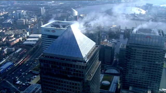 george osborne to challenge eu plans to cap bankers' bonuses lib view / aerial of canary wharf tower and bank hq buildings - ローラ・クエンスバーグ点の映像素材/bロール