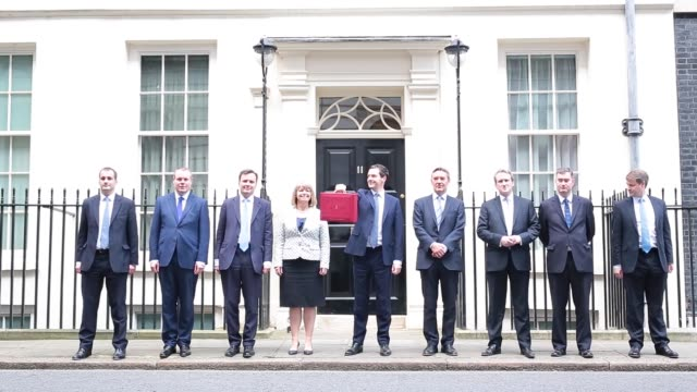 george osborne uk chancellor of the exchequer centre holds the dispatch box containing the budget as members of the hm treasury join him in front of... - chancellor of the exchequer stock videos and b-roll footage