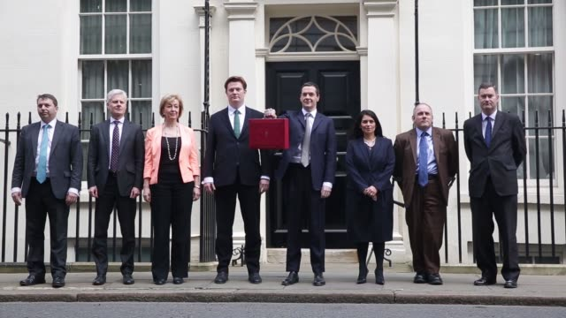 george osborne uk chancellor of the exchequer holds the dispatch box containing the 2015 budget as he stands outside 11 downing street in london uk... - chancellor of the exchequer stock videos and b-roll footage