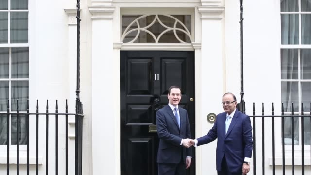 george osborne uk chancellor of the exchequer left shakes hands with arun jaitley india's finance minister on the steps of 11 downing street ahead of... - minister clergy stock videos and b-roll footage